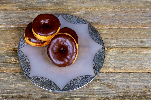Homemade glazed autumn pumpkin donuts ready to eat