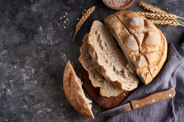Homemade gluten free bread on a napkin on the kitchen table