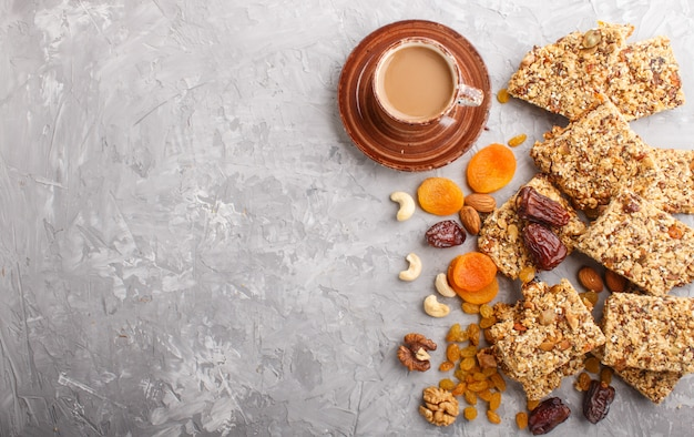 Homemade granola from oat flakes, dates, dried apricots, raisins, nuts with a cup of coffee. top view.