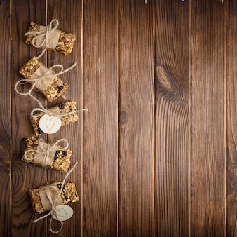 Homemade granola oatmeal energy bars, healthy snack, on wood table, top view