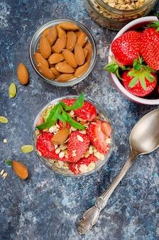 Homemade  granola with fresh strawberries