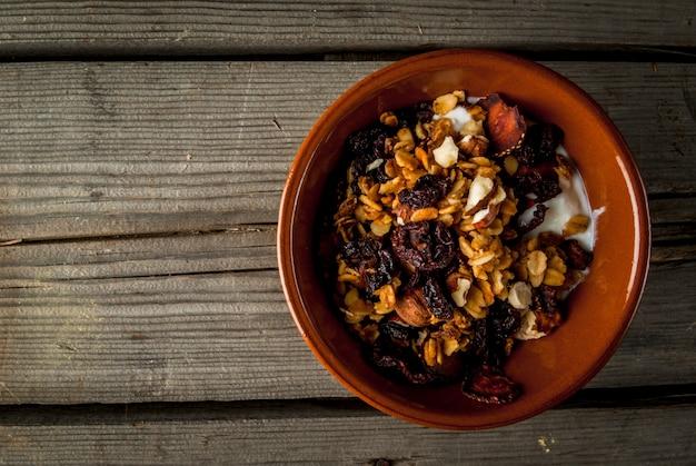 Homemade granola with  fruits, nuts and yogurt