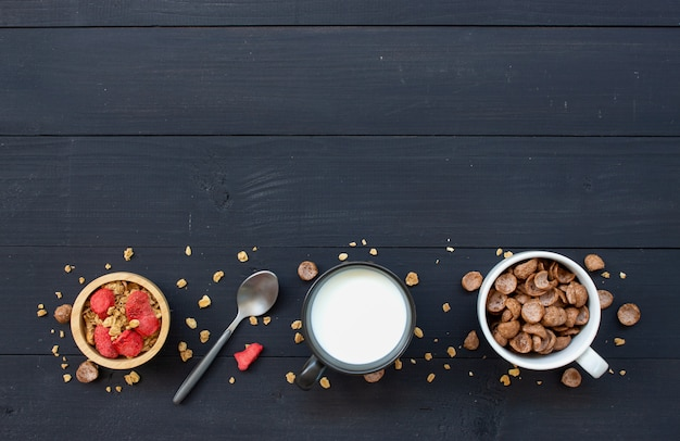 Homemade granola with milk for breakfast on wooden table