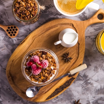 Homemade granola with nuts and dried fruit and chocolate for breakfast