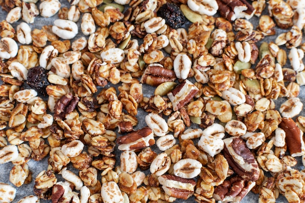 Homemade granola with pecan nuts close up, top view