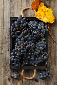 Homemade grapes in a black box on old wooden