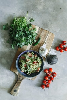 Homemade guacamole with cherry tomatoes food photography recipe idea