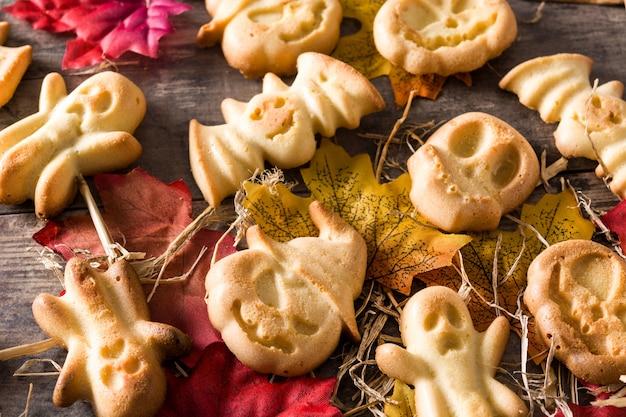 Homemade halloween cookies on wooden table