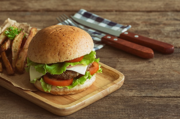 Homemade hamburger or sandwich with meat or pork ham cheese and fresh vegetable