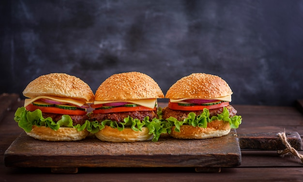 Homemade hamburger with beef, onion, tomato