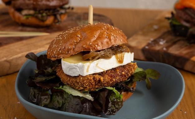 Homemade hamburger with juicy chicken breast battered with kikos, oak leaf, mushrooms