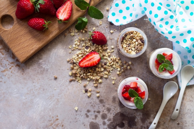 Homemade healthy breakfast with homemade baked granola fresh strawberry and yogurt copy space