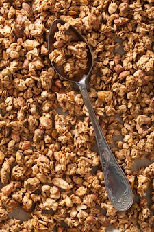 Homemade healthy granola on backing paper background