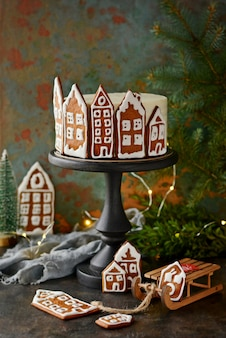 Homemade honey cake with sour cream, decorated with gingerbread. rustic style. christmas decor, atmosphere