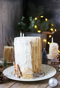 Homemade honey cake with sour cream, decorated with gingerbread