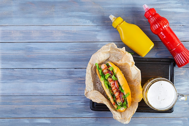 Homemade hot dog with sausage on wooden background