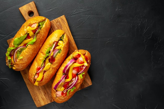 Homemade hot dogs on a stone background  with copy space for your test