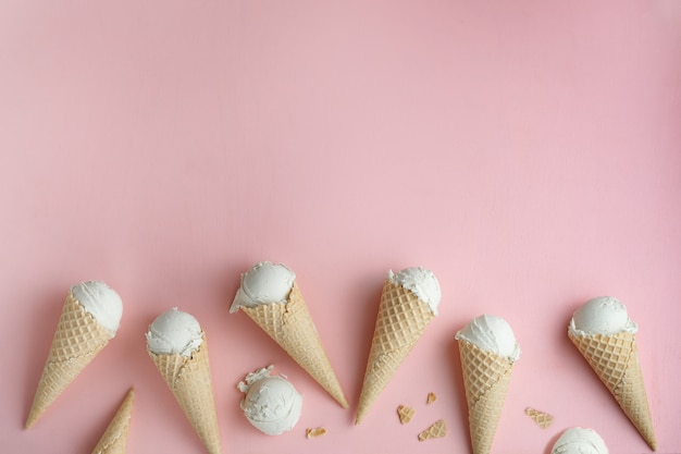 Homemade ice cream in a waffle cones on pink background. copyspace for a text
