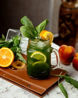 Homemade ice tea with herbs and orange