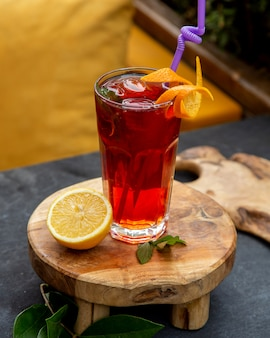 Homemade ice tea with side lemon