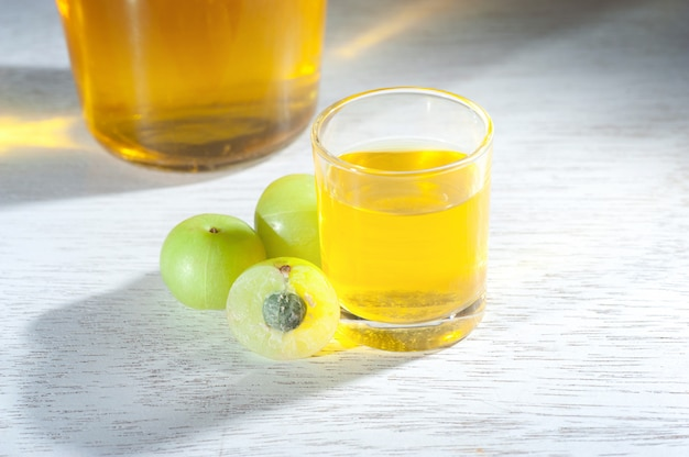 Homemade indian gooseberry liqueur juice with close up shot