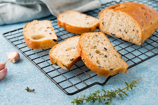 Homemade italian ciabatta bread with herbs, garlic and olives, selective focus
