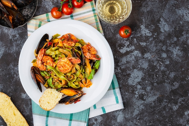 Homemade italian seafood pasta tagliatelle with mussels and shrimp
