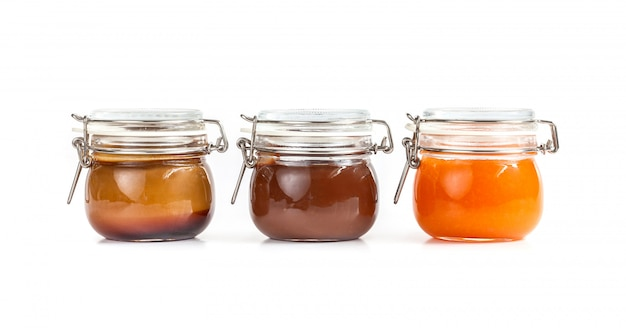 Homemade jam in transparent glass jars