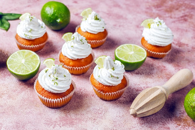 Homemade key lime cupcakes with whipped cream and lime zest, selective focus