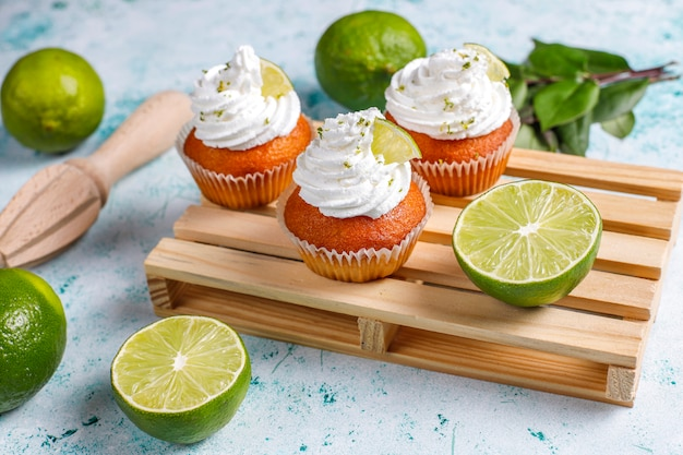 Homemade key lime cupcakes with whipped cream and lime zest,selective focus