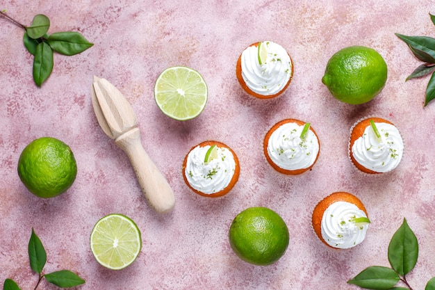 Homemade key lime cupcakes with whipped cream and lime zest