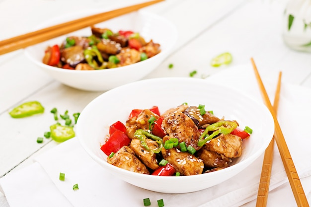 Homemade kung pao chicken with peppers and vegetables.