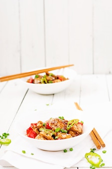 Homemade kung pao chicken with peppers and vegetables