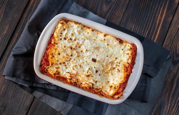 Homemade lasagne in baking pan: top view