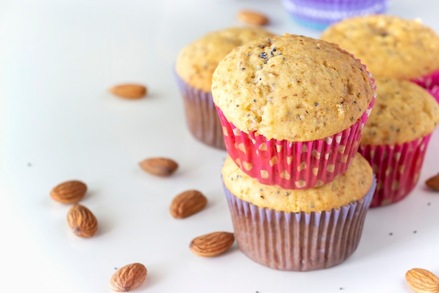 Homemade lemon muffins with colorful chocolate candy in paper case and cup tea