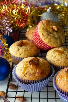 Homemade lemon muffins with poppy seeds and almond in paper case
