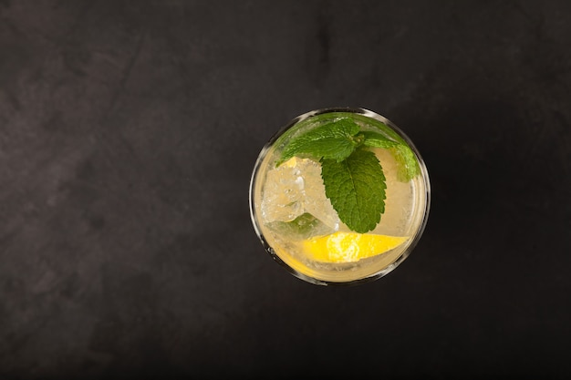 Homemade lemonade or mojito cocktail with lemon top view refreshing summer drink