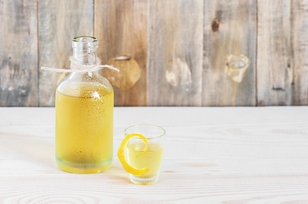 Homemade limonchello on the wooden background