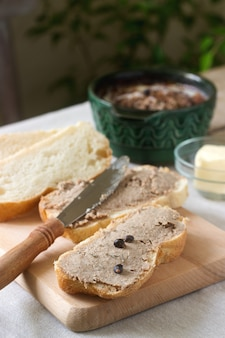 Homemade liver pate with bread and butter. rustic style.
