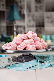 Homemade marshmallows. pink marshmallows on a platter in a bakery. homemade sweets.