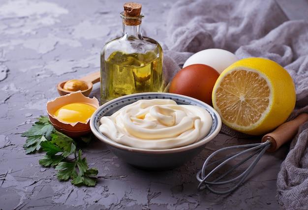 Homemade mayonnaise sauce and olive oil, eggs, mustard, lemon. selective focus