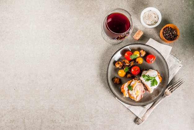 Homemade meat cutlet cordon bleu grey stone background