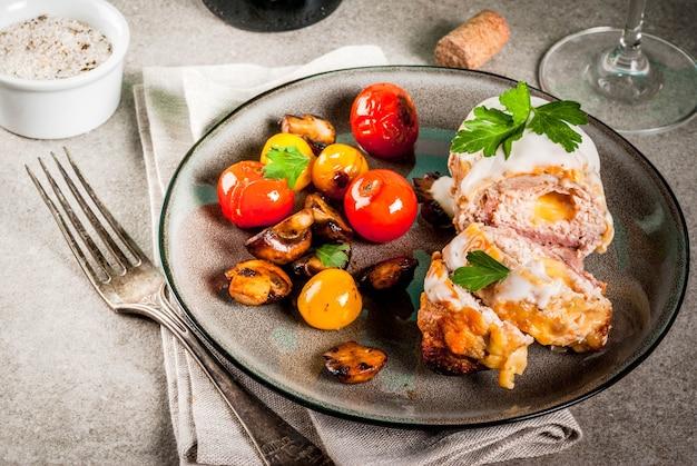 Homemade meat cutlet cordon bleu grey stone background