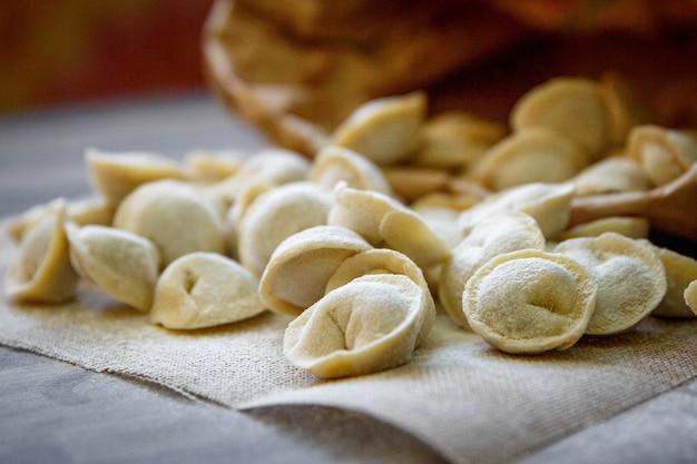 Homemade meat dumplings - russian pelmeni.