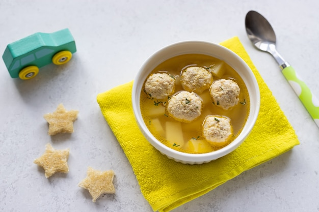Homemade meatballs soup for children with croutons healthy food for children