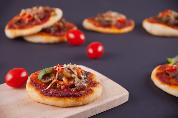 Homemade mini pizza on black
