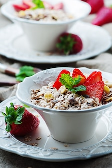 Homemade muesli with strawberry and mint