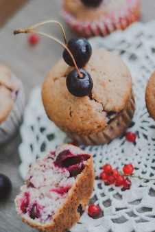 Homemade muffins stuffed with cherries and red currant