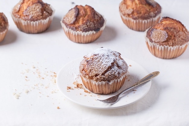 Homemade muffins with powdered sugar
