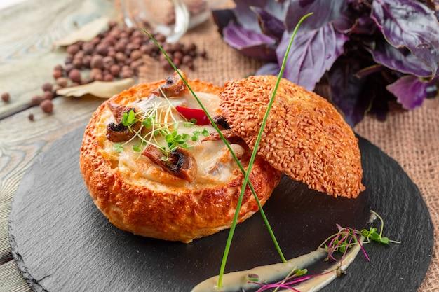 Homemade mushroom cream soup served in bread bowl